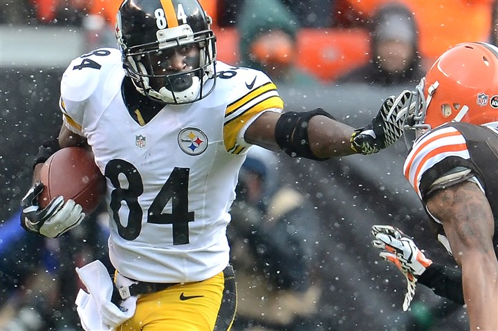 tony1229-1 Antonio Brown stiff arms Cleveland's Buster Skrine before picking up six yards against the Browns at First Energy Stadium in Cleveland in November.