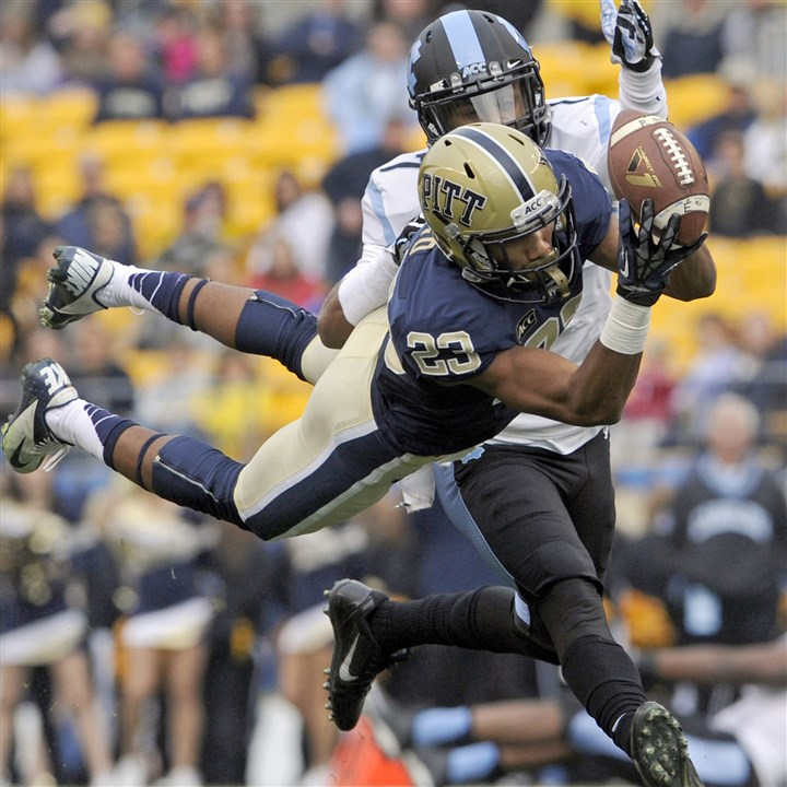 20131116mfpittsports01.jpg Pitt's Tyler Boyd pulls in a pass against North Carolina's Tim Scott during a game last year at Heinz Field.