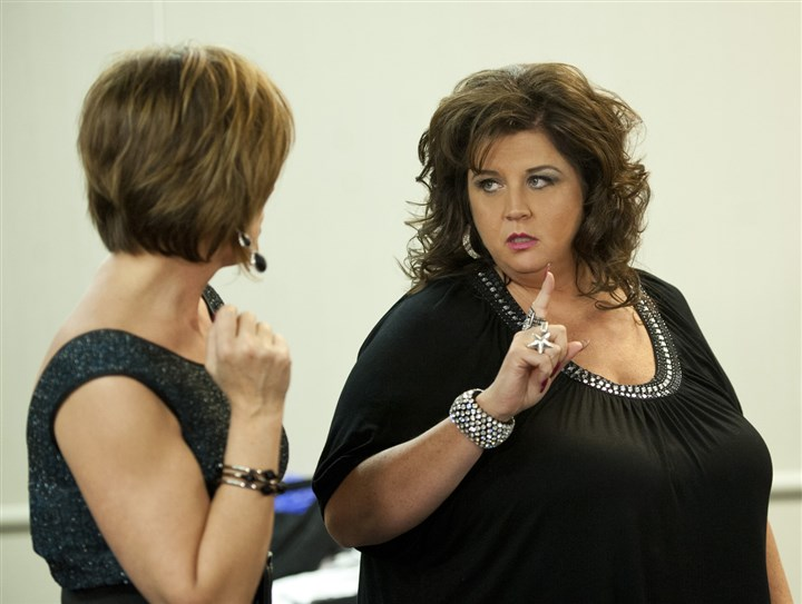 "Dancemoms Abby Lee Miller, center, in Lifetime's ""Dance Moms."""