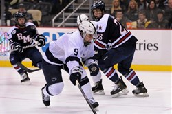 Penn State's David Goodwin (9) takes a shot on goal against hockey rival Robert Morris in 2013 at Consol Energy Center.