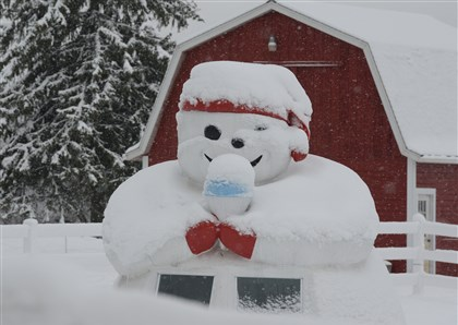 "9kp00kkt.jpg The ""Snowman Shaved Ice"" stand along Route 488 east of Portersville , Pa., is covered in the overnight snowfall."