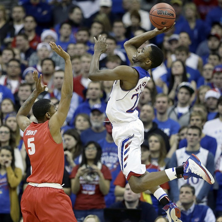 wiggins0324 Kansas' Andrew Wiggins, right, shoots against a New Mexico player in a game earlier this season.