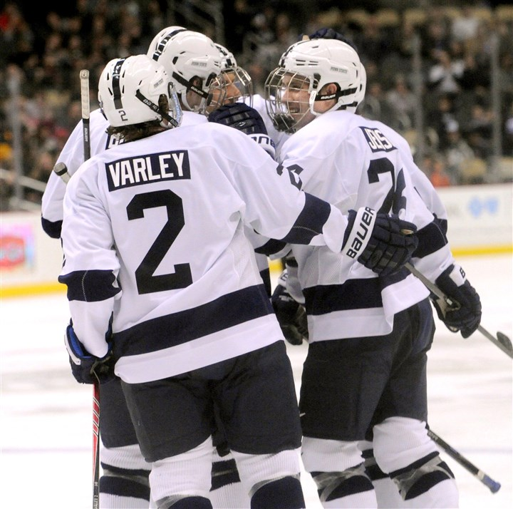 20131227JHSportsHockey08-4S Penn State celebrates its first goal of the game Friday against Robert Morris in the Three Rivers Classic at Consol Energy Center.