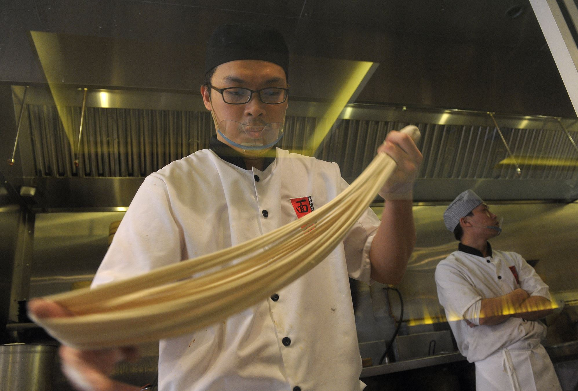 JoshHu At Everyday Noodles in Squirrel Hill, head chef Josh Hu prepares traditional Taiwanese noodles by hand.