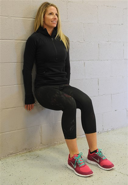 EXERCISE 2 / WALL SIT EXERCISE 2 / WALL SIT: Start with your back against a wall, your feet shoulder-length apart and about 2 feet from the wall. Slowly slide your back down the wall until your thighs are parallel to the ground. Form a right angle at your hips and knees.