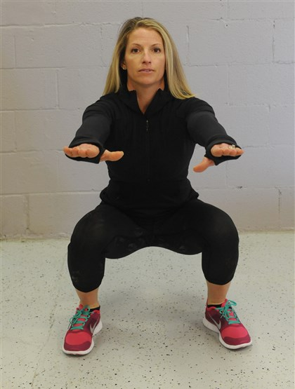 EXERCISE 6 / SQUATS EXERCISE 6 / SQUATS: Place your feet a little wider than shoulder-length apart. Extend your arms out straight, palms facing down. Inhale, send your hips backward as you bend your knees, keeping your back straight and your eyes forward. Try to lower your hip joint below your knees. (The wider your stance, the easier it is to make your squat deeper and the more muscle groups you�