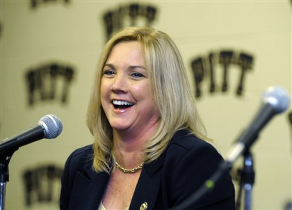 20131228_serio Suzie McConnell-Serio laughs after being announced as the new Pitt women's basketball coach in April.