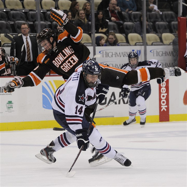 rmuhock1229 RMU's David Rigatti collides with Bowling Green's Adam Berkle in the second period Saturday at Consol Energy Center.