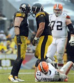 Brett Keisel and Cameron Heyward celebrate after forcing Browns quarterback Jason Campbell to fumble during a game last season at Heinz Field on Sunday, December 29, 2013.