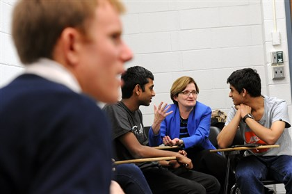 "20131225jhCMULoc01.jpg The ""thrive @ CMU"" course was launched this year to help new students find a work-life balance. In a class this month, Amy Burkert, a vice provost for education, talks with students Arjun Manimaran, left, and Amnth Deepak. Associate history professor Nico Slate is at left."