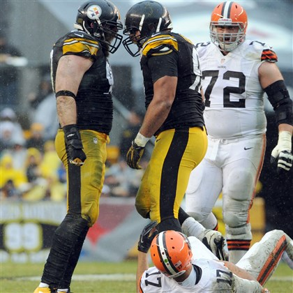 20131229mfsteelerssports04-2 The Steelers' Brett Keisel and Cam Heyward celebrate after forcing Browns quarterback Jason Campbell to fumble in the first quarter at Heinz Field Sunday.