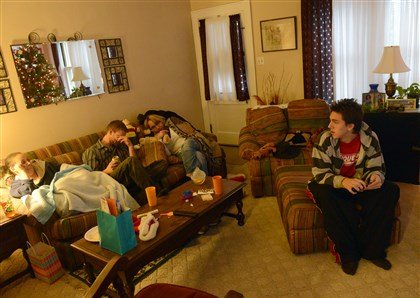 20131128lfPressleyRidgeSpor.1 Dante Yobst, 17, spends time with his mother, Tracy Yobst, near left, uncle Norman Wilson and aunt Ann Verret at his grandmother's home in Sheraden on Thanksgiving Day.