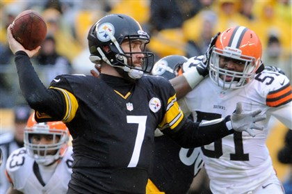 Steelers quarterback Ben Roethlisberger Steelers quarterback Ben Roethlisberger gets a throw off against the Browns in the third quarter at Heinz Field Sunday, December 29, 2013.