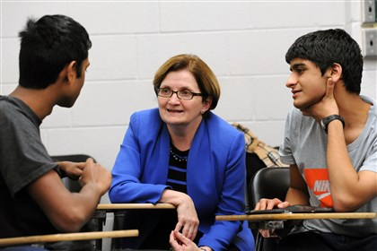 "20131225jhCMULoc02.jpg Students Arjun Manimaran, left, and Amnth Deepak, right, converse with Amy Burkert, a CMU vice provost for education, at the ""thrive @ CMU"" course to help new students find a work-life balance."