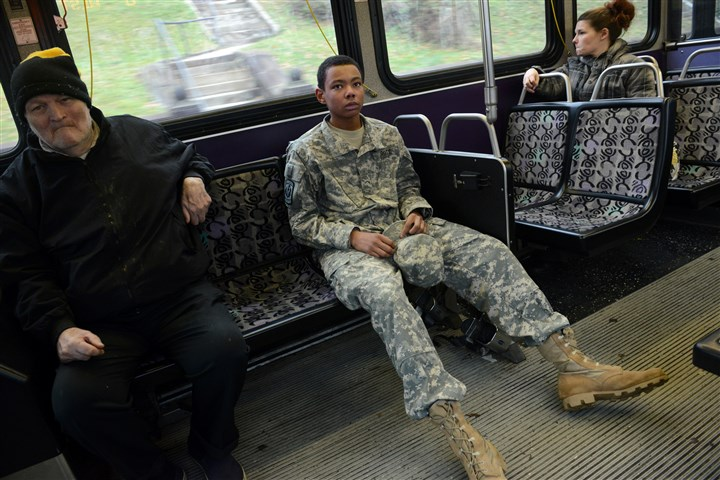 20131206lfPressleyRidgeSpor.8_co-6 Wearing the fatigues of his Junior ROTC group, Kurtis Haddock rides the bus to Perry Traditional Academy after spending the morning at Pressley Ridge in early December.