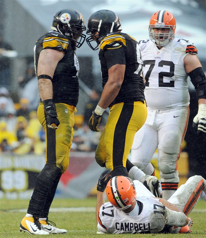 20131229mfsteelerssports04-2 Steelers' Brett Keisel and Cameron Heyward celebrate after forcing Browns quarterback Jason Campbell to fumble in the first quarter Sunday at Heinz Field.