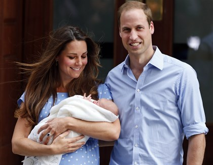 Britain Royal Baby Kate, Duchess of Cambridge, and Prince William with their new son George. The new mom did nothing to hide her baby belly in her first public appearances after the infant's birth in July.