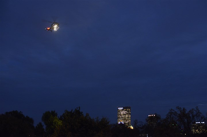 20131226jrLocFlight02.jpg A LifeFlight helicopter prepares to land at Allegheny General Hospital on the North Side.