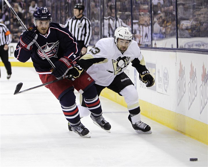 Penguins Blue Jackets Hockey Columbus Blue Jackets' James Wisniewski, left, and the Penguins' Chris Conner chase a loose puck during the first period Sunday in Columbus, Ohio.