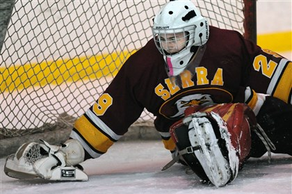 20131118JHSports HS Hockey0.8.jpg Despite facing a barrage of shots this season, including this one against Quaker Valley Nov. 18, Serra Catholic goalie Ian Ritchie has been strong in net for the Eagles.