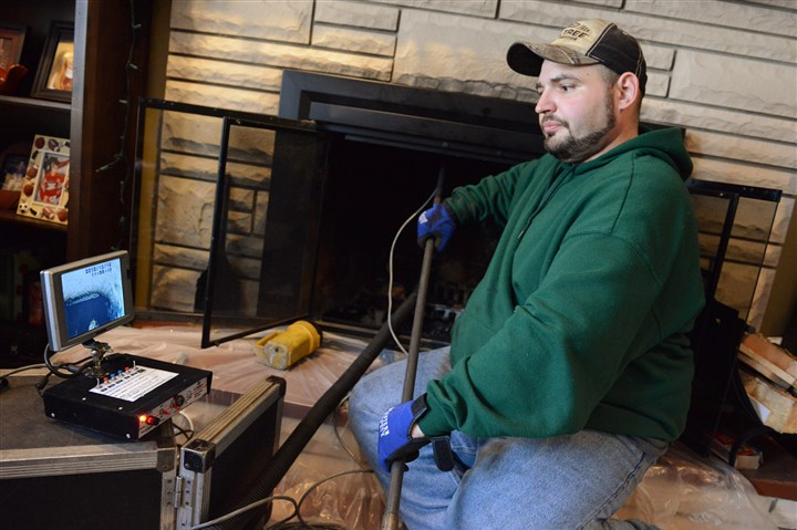 20140103_january.jpg Chris Rankin, who works for Advanced Chimney Sweeps in Indiana Township, says modern technology allows technicians to conduct a more thorough inspection for buildup and debris.