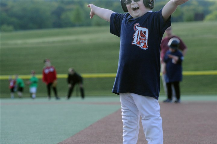 20140103_july.jpg Charlie Osborn signals himself safe at first base during a Miracle League game in Murrysville.