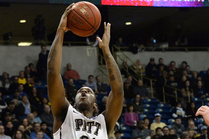 20131231pittsports03-2 Pitt's Lamar Patterson drives to the net against Albany in the first half at the Petersen Events Center Tuesday afternoon.