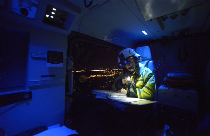 201312jrLifeFlightLocal7.jpg Nurse Elaine Hruby goes over procedures in the back of the helicopter as she prepares to pick up a heart-attack victim at a hospital in Latrobe and transport him to West Penn Hospital for immediate surgery.