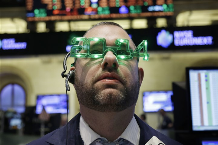20131231wap_wallstreetcloseA A trader wears glasses celebrating the new year while wrapping up the work of the old one on the floor at the New York Stock Exchange in New York, Tuesday, Dec. 31, 2013.
