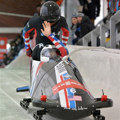 20140103hoSportsWilliams.jpg Driver Elana Meyers raises her hand while brakeman Lauryn Williams pushes in a World Cup event Dec. 14 in Lake Placid.