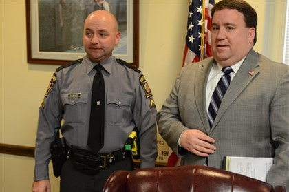 20140102dsPetroLocal03-2 State Trooper Mark McMahan and Indiana County district attorney Pat Dougherty are seen here at the end of a news conference on the fatal shooting of Frank Petro in Conemaugh. Jack Oliver Edmundson Jr., 43, has been charged and is under guard at UPMC Presbyterian in Pittsburgh.
