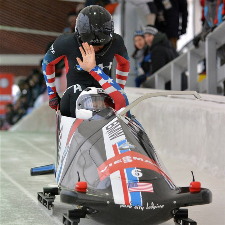 U.S. bobsled Elana Meyers, Lauryn Williams Driver Elana Meyers raises her hand while brakeman Lauryn Williams pushes in a World Cup event Dec. 14 in Lake Placid.