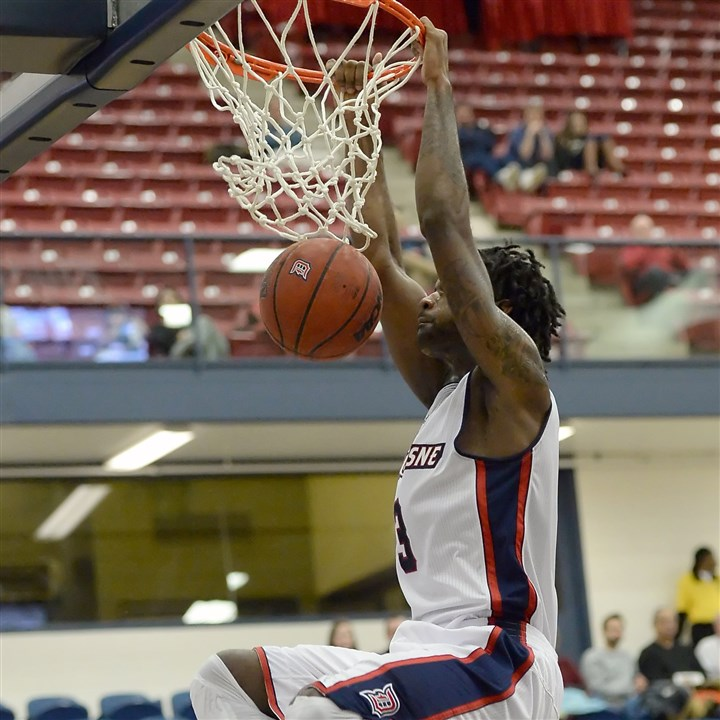 20140102mfdukessports04 Duquesne's Dominique McKoy dunks against Appalachian State earlier this month.