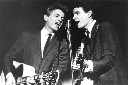 Obit Phil Everly.JPEG-0162f This July 31, 1964 file photo shows The Everly Brothers, Don, left, and Phil, performing on stage.