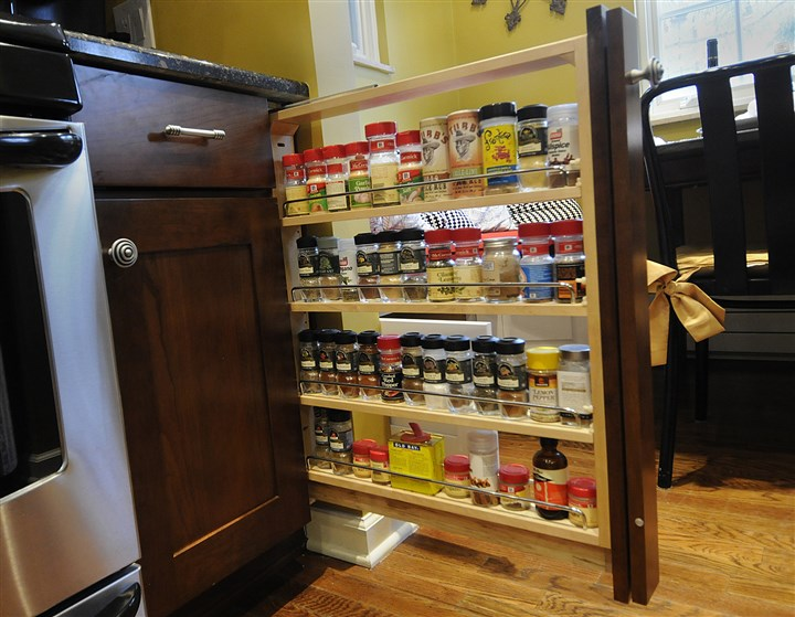 20131218lrkitchenmag07 Pull out shelves next to the stove for spices.