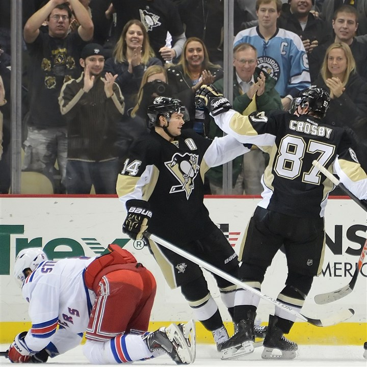 20140103pdPenguinsSports02 Chris Kunitz celebrates a goal by Sidney Crosby in the second period against the Rangers in January at the Consol Energy Center.
