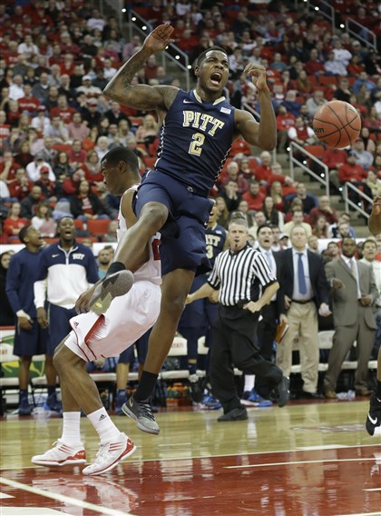 pitt0105e-4 Michael Young reacts as he dunks over North Carolina State's T.J. Warren during the second half in Raleigh, N.C., Saturday.
