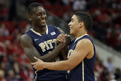 pitt0105d-3 Talib Zanna, left, and James Robinson celebrate near the end of the game against North Carolina State in Raleigh, N.C., Saturday.