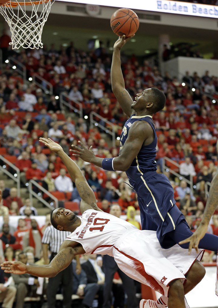 pitt0105b-1 Talib Zanna drives to the basket as North Carolina State's Lennard Freeman draws a foul during the second half in Raleigh, N.C., Saturday.