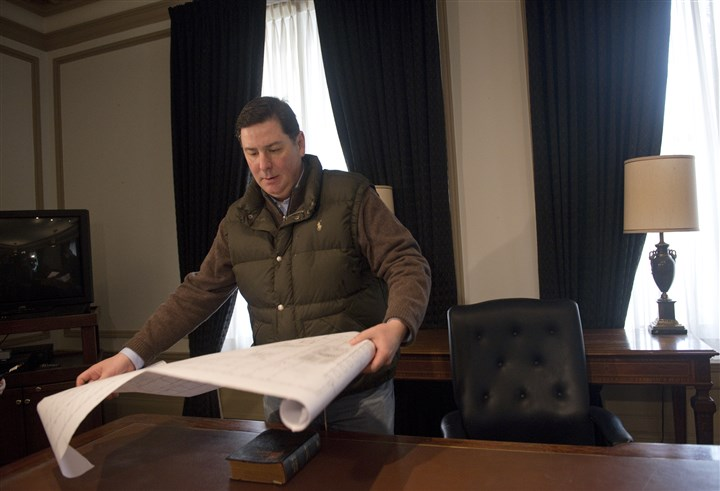Bill Peduto Mayor-elect Bill Peduto spreads out the floor plans of his new office so he can discuss office assignments with his staff Saturday at the City-County Building.