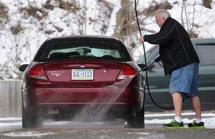 20140105radColdWeatherLocal02 Temperature in the mid-20s didn't keep Richard McAllister of Castle Shannon from washing his car while wearing shorts Sunday morning at McBubble Car Wash on Route 88.