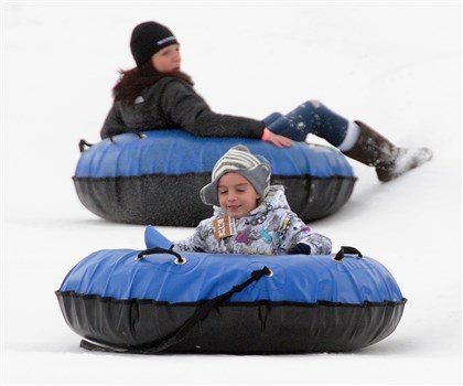 20140105radSnowTubeLocal01-2 Linda Mehaffie and her son, Anthony Maiovana, 6, ride the snow tube course at the Boyce Park ski slopes on Sunday. They are from Cranberry.