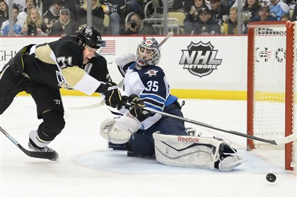 cook0106 Evgeni Malkin had two goals in his first game back from injury to help the Penguins beat Winnipeg Sunday.