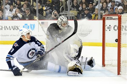 pennot0106 Winnipeg's Evander Kane puts the puck past Penguins goalie Marc-Andre Fleury in the second period Sunday.