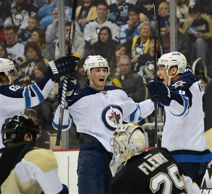 Evander Kane The Jets' Evander Kane, far right, celebrates his second goal of the game against the Penguins in the second period.