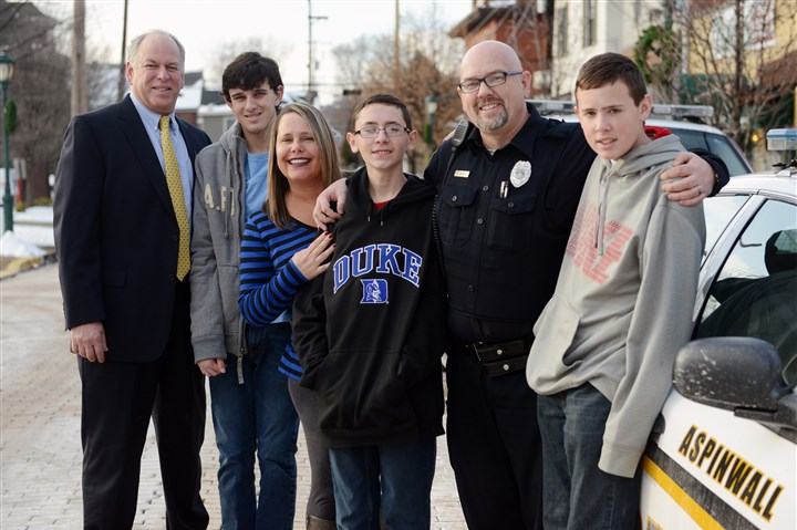 20140104bwAutisticLocal02 Allegheny County deputy district attorney Tom Swan, left, poses with his son Kevin and the family of Aspinwall police Officer Scott Bailey: Tina, Trevor, 15, and Trent, 14. The three boys are autistic, and the families are part of a training video for police.