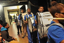 Members of the George Westinghouse High School drum line make their way onto the stage at Heinz Hall to entertain before the swearing-in of Bill Peduto as Pittsburgh's mayor in 2014.