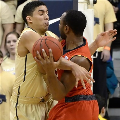 pittbb0125 Pitt's James Robinson fouls Maryland's Dez Wells at the Petersen Events Center earlier this season.