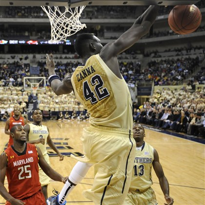010614mfpittsports06-2 Pitt's Talib Zanna blocks a shot by Maryland's Jake Layman in the first half at the Petersen Events Center Monday night.