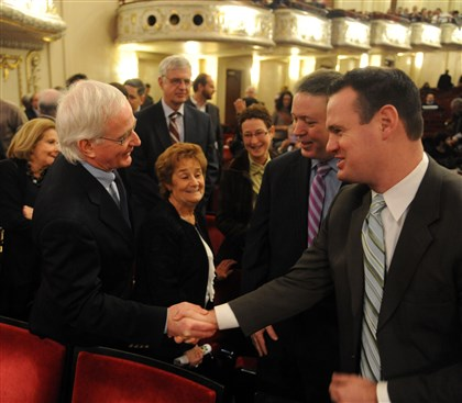 20130106MWHpedutoLocal08-3 Luke Ravenstahl, right, the outgoing mayor, shakes hands with Tom Murphy, another former mayor, Monday during the swearing-in of Mayor Bill Peduto.